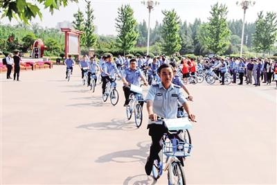 """破""""坎""""前行,打造城市风景线——河南省漯河市精细化管控共享单车"""